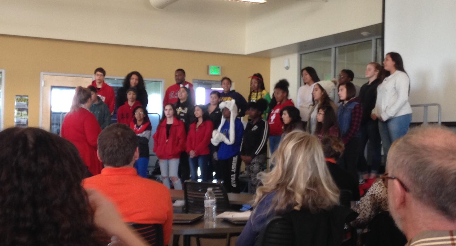 In anticipation of their December 13 performance, the AHS choir sings holiday songs to the AHS faculty.