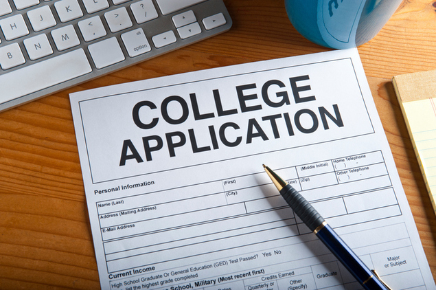 Blank college application on a desktop. Artwork created by the photographer.