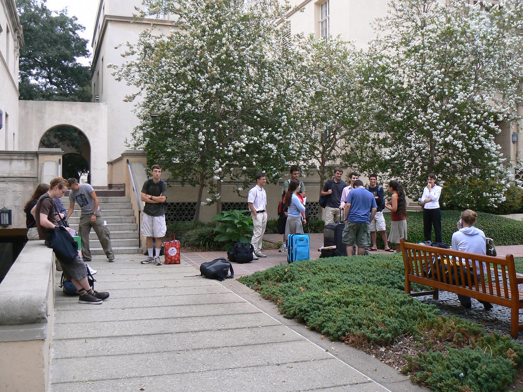 Students gather outside of one of the iconic buildings at CalTech, waiting for classes to begin.