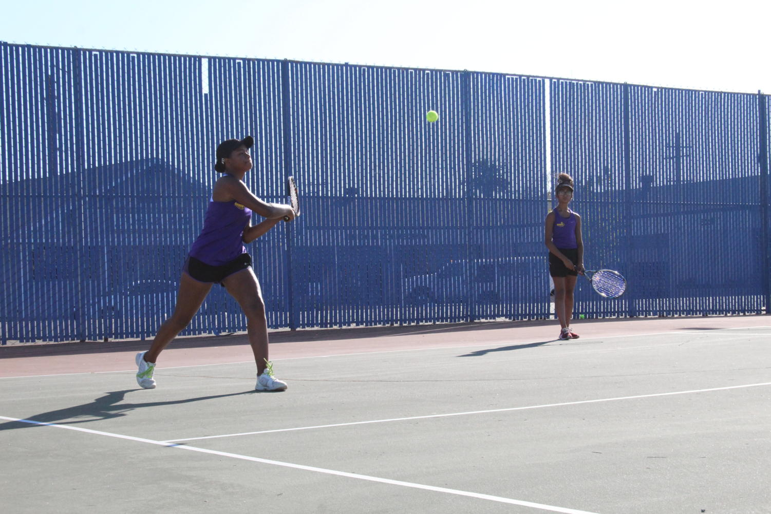 Two players playing tennis