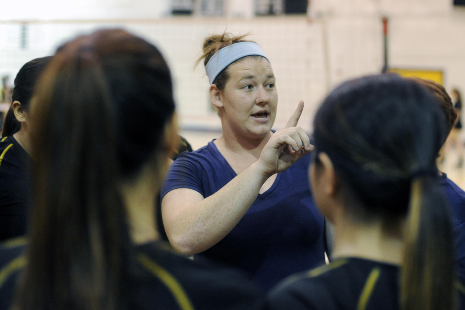 Armijo volleyball coach Paige McConlogue speaks to her team before the match against Vacaville at Armijo High School in Fairfield, Thursday. (Aaron Rosenblatt/Daily Republic)