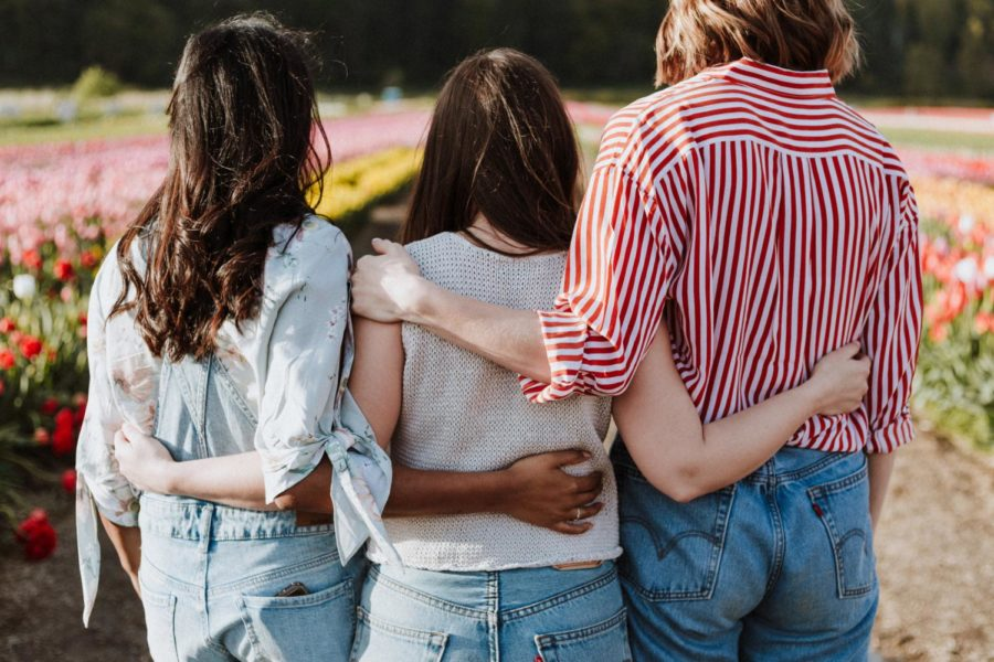 Three+women+having+each+other%27s+backs.
