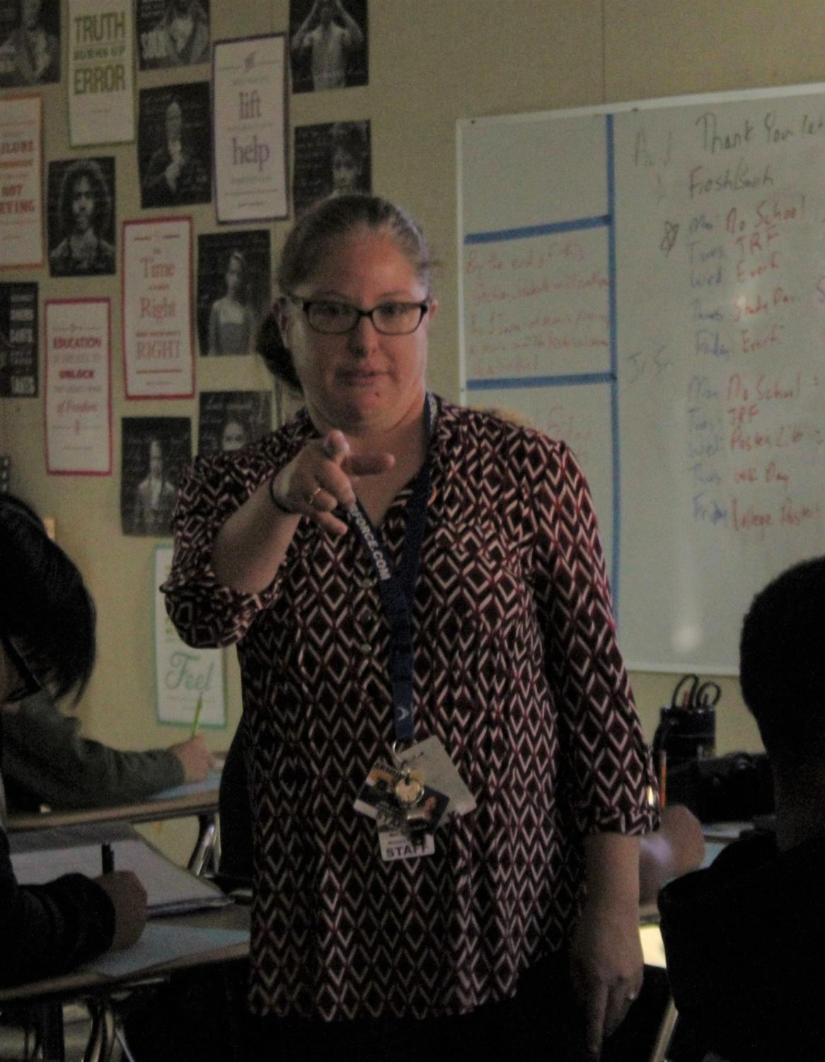 Ms. Lockhart points to the future by explaining the past.