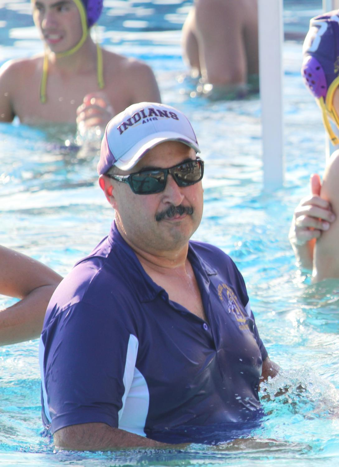 Coach Marin joins his players in the pool so he can show them what to do.