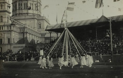 Children in 1901 dance around the May Pole in this traditional activity.