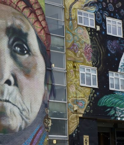 Graffiti of a Native American woman on the side of a building in East London.