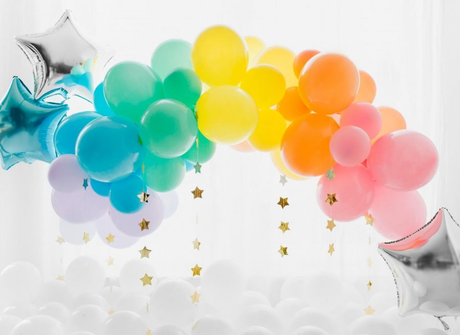 Everyone is happier when they get a bunch of balloons.