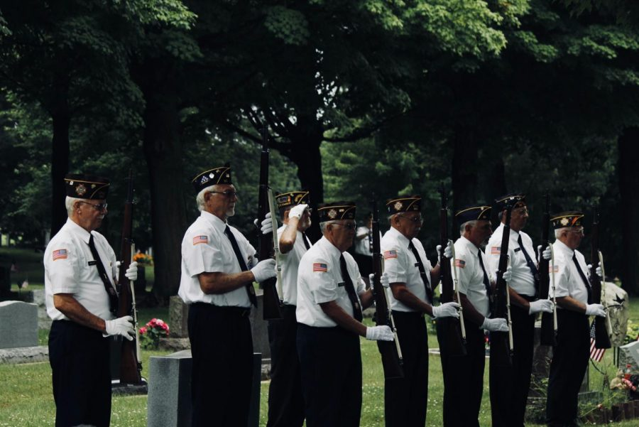 Military honors are recognized through a 21-gun salute.